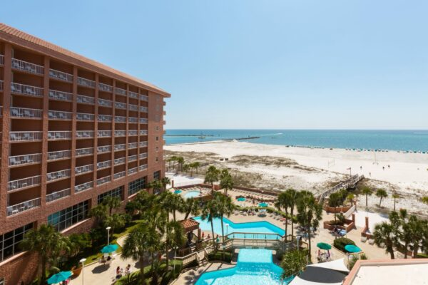 Perdido Beach Resort, with sparkling blue pools and a view of the beach